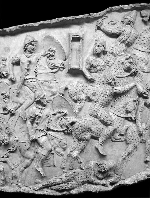 Auxiliary Calvary attack armored men and horses: the cataphract Roxolan cavalry. From Casts (#93-4) now in the Museo della Civiltà Romana, Rome. Compare Cichorius Pl. XXVIII, scene 37 and Coarelli Pl. 38. Ref: RBU2011.7047